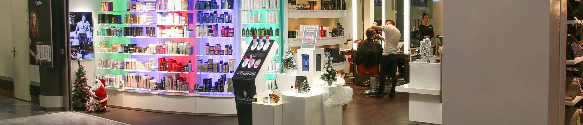 digital signage flying shelf regalleisten schwarzkopf coiffina
