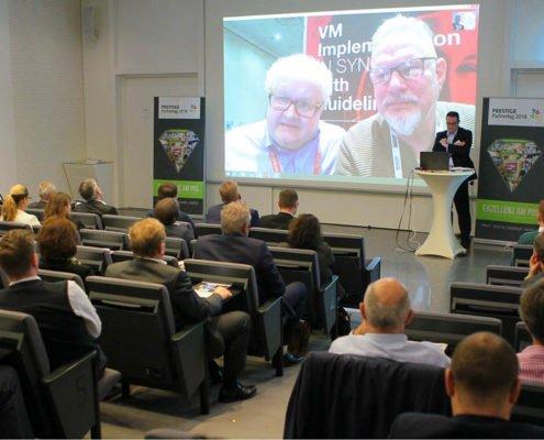 Volker Wissmann und Frank Rehme berichten auf dem PRESTIGE Partnertag live von der NRF 2018